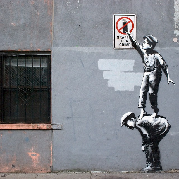 BanksyNYC-Banksy-Graffiti-is-a-Crime-Chinatown-NYC